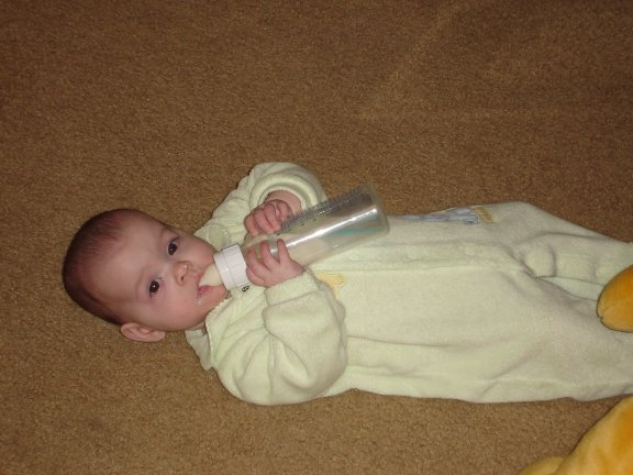 Jenna holds her bottle.