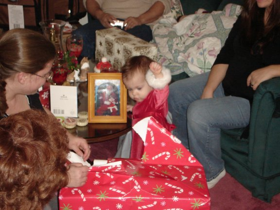 Jenna opens more presents.